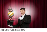 Купить «Businessman demonstrating magic . Mixed media», фото № 25573897, снято 22 марта 2019 г. (c) Sergey Nivens / Фотобанк Лори