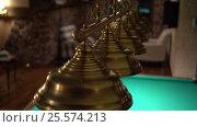 Metallic lamp shades swinging above a billiard table. Handheld shot. Стоковое видео, видеограф Павел Котельников / Фотобанк Лори