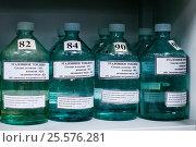 Купить «Ёмкости с эталонным топливом в лаборатории по контролю качества на нефтебазе», эксклюзивное фото № 25576281, снято 12 февраля 2017 г. (c) Александр Тарасенков / Фотобанк Лори