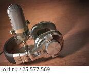 Купить «Microphone and headphones on the wooden table. Retro vintage style background. Radio concept», фото № 25577569, снято 15 декабря 2018 г. (c) Maksym Yemelyanov / Фотобанк Лори