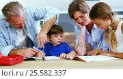 Купить «Father and mother helping children with homework», видеоролик № 25582337, снято 4 апреля 2020 г. (c) Wavebreak Media / Фотобанк Лори