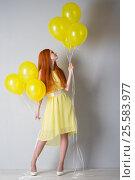 Купить «Young woman with balloons», фото № 25583977, снято 16 февраля 2017 г. (c) Типляшина Евгения / Фотобанк Лори