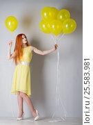 Купить «Young woman with balloons», фото № 25583981, снято 16 февраля 2017 г. (c) Типляшина Евгения / Фотобанк Лори