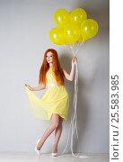 Купить «Young woman with balloons», фото № 25583985, снято 16 февраля 2017 г. (c) Типляшина Евгения / Фотобанк Лори