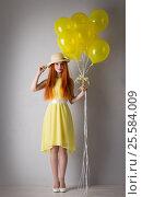 Купить «Young woman with balloons», фото № 25584009, снято 16 февраля 2017 г. (c) Типляшина Евгения / Фотобанк Лори