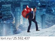 Купить «Businessman carrying the piggybank with savings», фото № 25592437, снято 16 октября 2019 г. (c) Elnur / Фотобанк Лори