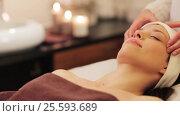 Купить «woman having face and head massage at spa», видеоролик № 25593689, снято 28 января 2017 г. (c) Syda Productions / Фотобанк Лори