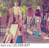 Купить «kids playing on playground», фото № 25599437, снято 19 июня 2019 г. (c) Яков Филимонов / Фотобанк Лори