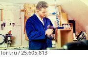 Male worker finishing to drill drawer. Стоковое фото, фотограф Яков Филимонов / Фотобанк Лори