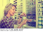 Купить «mature woman in sewing store», фото № 25609437, снято 23 мая 2019 г. (c) Яков Филимонов / Фотобанк Лори