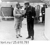 Купить «New York, New York: May 2, 1927 Mrs. Clemington Corson, (formerly Amelia Millie Gade) being congratulated by U.S. Navy Rear Admiral Yates Sterling, Chief...», фото № 25610781, снято 2 февраля 2017 г. (c) age Fotostock / Фотобанк Лори