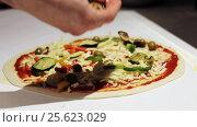Купить «cook cooking pizza at pizzeria», видеоролик № 25623029, снято 17 февраля 2017 г. (c) Syda Productions / Фотобанк Лори