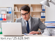 Купить «Handsome businessman working in the office», фото № 25628941, снято 18 октября 2016 г. (c) Elnur / Фотобанк Лори
