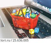 Купить «Laptop computer application software icons in the shopping basket. Store of apps concept.», фото № 25636005, снято 27 мая 2018 г. (c) Maksym Yemelyanov / Фотобанк Лори