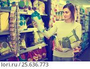 Купить «woman choosing delicious snacks in supermarket», фото № 25636773, снято 23 ноября 2016 г. (c) Яков Филимонов / Фотобанк Лори