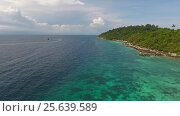 Aerial view on stone coast of Ko Lipe island. Стоковое видео, видеограф Михаил Коханчиков / Фотобанк Лори