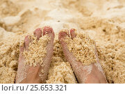 Holiday concept. Woman feet close-up relaxing on beach, enjoying sun and splendid view. Стоковое фото, фотограф Ольга Горд / Фотобанк Лори