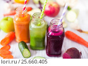 Купить «Freshly squeezed vegetable juice in bottles, useful vitamin cocktail, detox diet, selective focus», фото № 25660405, снято 26 мая 2020 г. (c) Екатерина Яценко / Фотобанк Лори