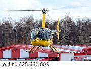 Купить «Вертолет Robinson R44 (бортовой RA-04172) в полете», эксклюзивное фото № 25662609, снято 25 февраля 2017 г. (c) Alexei Tavix / Фотобанк Лори