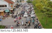 Купить «HO CHI MINH, VIETNAM - OCTOBER 13, 2016: Peak hour. Dense traffic in Ho Chi Minh City. Vietnam.», видеоролик № 25663165, снято 13 октября 2016 г. (c) Mikhail Davidovich / Фотобанк Лори