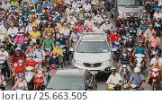 Купить «HO CHI MINH, VIETNAM - OCTOBER 13, 2016: Peak hour. Dense traffic in Ho Chi Minh City. Vietnam.», видеоролик № 25663505, снято 13 октября 2016 г. (c) Mikhail Davidovich / Фотобанк Лори