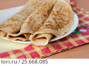 Delicious pancakes on Shrove Tuesday in a plate. Стоковое фото, фотограф Катерина Белякина / Фотобанк Лори