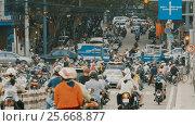 Купить «HO CHI MINH, VIETNAM - OCTOBER 13, 2016: Peak hour. Dense traffic in Ho Chi Minh City. Vietnam.», видеоролик № 25668877, снято 13 октября 2016 г. (c) Mikhail Davidovich / Фотобанк Лори