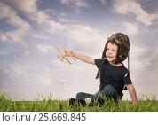 Купить «Boy playing with a model airplane», фото № 25669845, снято 2 марта 2017 г. (c) Типляшина Евгения / Фотобанк Лори