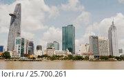 Купить «HO CHI MINH, VIETNAM - OCTOBER 13, 2016: Skyscrapers business center in Ho Chi Minh City on Vietnam Saigon on against a dirty shore», видеоролик № 25700261, снято 13 октября 2016 г. (c) Mikhail Davidovich / Фотобанк Лори