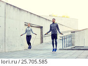 Купить «man and woman exercising with jump-rope outdoors», фото № 25705585, снято 17 октября 2015 г. (c) Syda Productions / Фотобанк Лори