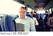 Купить «happy senior man reading newspaper in travel bus», фото № 25705621, снято 21 октября 2015 г. (c) Syda Productions / Фотобанк Лори