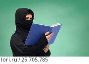 Купить «muslim woman in hijab reading book over white», фото № 25705785, снято 4 января 2017 г. (c) Syda Productions / Фотобанк Лори
