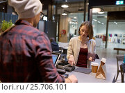 happy woman paying for purchases at cafe. Стоковое фото, фотограф Syda Productions / Фотобанк Лори