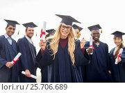 Купить «happy student with diploma celebrating graduation», фото № 25706689, снято 24 сентября 2016 г. (c) Syda Productions / Фотобанк Лори