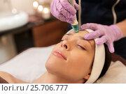 Купить «woman having microdermabrasion facial treatment», фото № 25706777, снято 26 января 2017 г. (c) Syda Productions / Фотобанк Лори