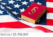 Купить «close up of american flag and lawbook», фото № 25706841, снято 30 июня 2016 г. (c) Syda Productions / Фотобанк Лори