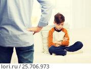 Купить «upset or feeling guilty boy and father at home», фото № 25706973, снято 24 октября 2015 г. (c) Syda Productions / Фотобанк Лори