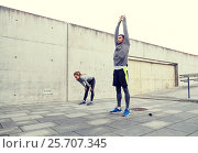 Купить «tired couple stretching after exercise», фото № 25707345, снято 17 октября 2015 г. (c) Syda Productions / Фотобанк Лори