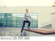 Купить «woman making step exercise on city street bench», фото № 25707365, снято 17 октября 2015 г. (c) Syda Productions / Фотобанк Лори