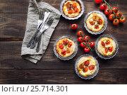 Купить «Fresh homemade tarts with cherry tomatoes and goat cheese», фото № 25714301, снято 19 февраля 2017 г. (c) Анастасия Изофатова / Фотобанк Лори