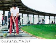 Купить «Man playing golf is going to hit ball at golf course», фото № 25714597, снято 16 июля 2018 г. (c) Яков Филимонов / Фотобанк Лори