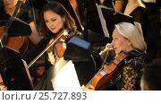 Купить «Ufa, RUSSIA - NOVEMBER 19, 2015: Symphony Orchestra at the Bashkir Theater of Opera and Ballet, Ufa», видеоролик № 25727893, снято 19 ноября 2015 г. (c) Mikhail Erguine / Фотобанк Лори