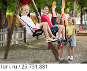Купить «View on children swinging together on children's playground», фото № 25731881, снято 16 июля 2018 г. (c) Яков Филимонов / Фотобанк Лори