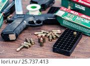 Купить «Пистолет и патроны», фото № 25737413, снято 28 марта 2020 г. (c) Михаил Михин / Фотобанк Лори