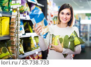 Купить «woman choosing delicious snacks in supermarket», фото № 25738733, снято 23 ноября 2016 г. (c) Яков Филимонов / Фотобанк Лори