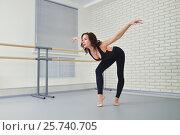Beautiful woman dancer in black bodysuit gracefully dancing ballet at studio. Стоковое фото, фотограф Сергей Дорошенко / Фотобанк Лори