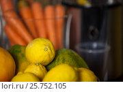 Купить «Close-up of lemon and papaya fruit», фото № 25752105, снято 4 октября 2016 г. (c) Wavebreak Media / Фотобанк Лори
