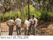 Купить «Military soldiers standing near fitness trial», фото № 25752205, снято 24 ноября 2016 г. (c) Wavebreak Media / Фотобанк Лори