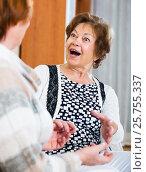 Купить «Elderly friends having nice conversation», фото № 25755337, снято 17 июля 2018 г. (c) Яков Филимонов / Фотобанк Лори