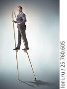 Купить «Businessman walking on stilts - standing out from the crowd», фото № 25760605, снято 23 февраля 2019 г. (c) Elnur / Фотобанк Лори